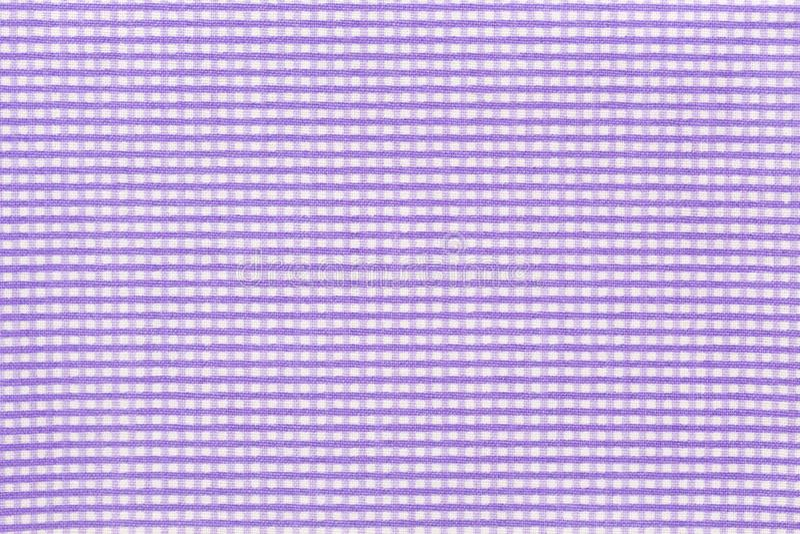 Zamyka w górę pasiastej purpur i bielu tkaniny tekstury zdjęcie stock