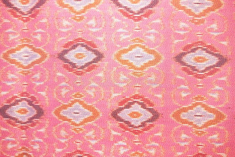 Zamyka w górę różowego jedwabniczego rękodzieła, tkaniny mody projekt, Piękny Tajlandzki stylowy tkanina wzoru tło, tekstura Tajl fotografia royalty free