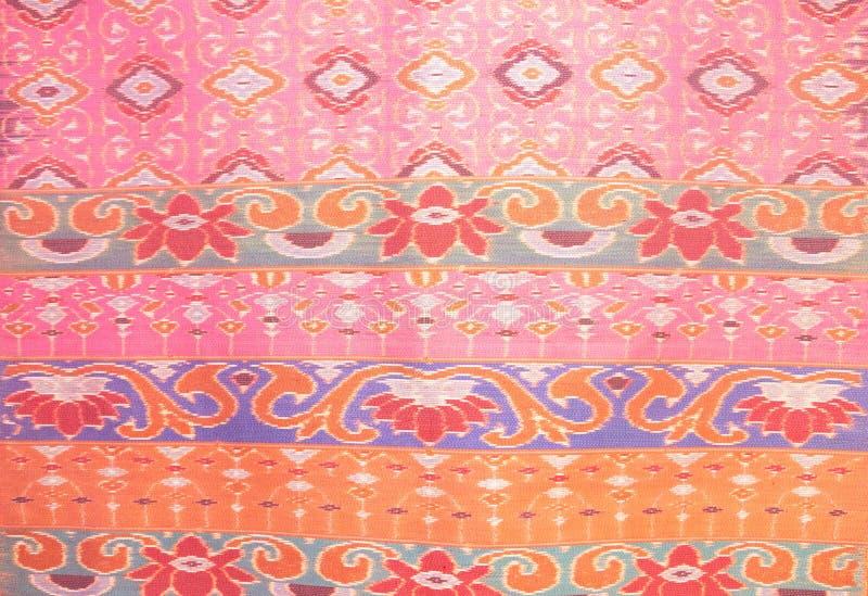 Zamyka w górę różowego jedwabniczego rękodzieła, tkaniny mody projekt, Piękny Tajlandzki stylowy tkanina wzoru tło, tekstura Tajl zdjęcia stock