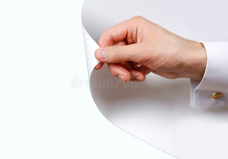 Zamyka w górę ręka zwrota białej strony Obracać stronę od bielu wh zdjęcie royalty free