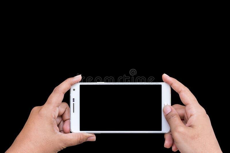 Zamyka w górę ręki kobiety mienia smartphone odizolowywający na czerni Sav fotografia stock