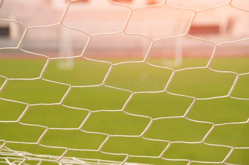 Zamyka w górę siatka futbolowego celu światła i fotografia stock