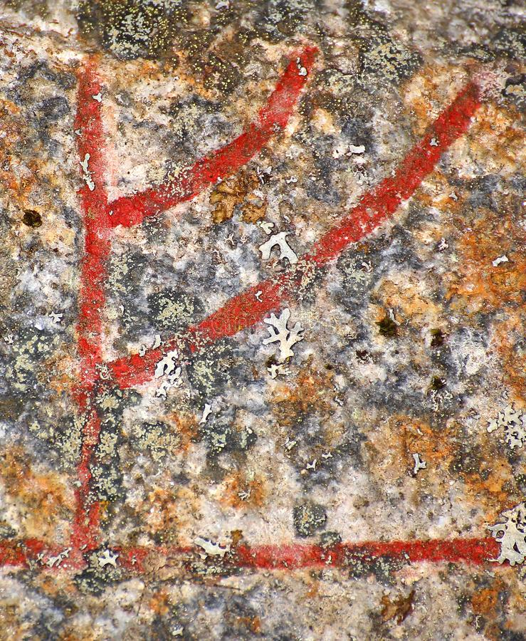 Zamyka w górę Skandynawskiego rune Fe od antycznego runestone fotografia royalty free