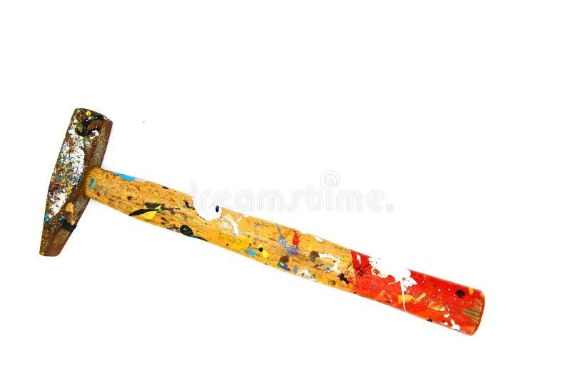 Zamyka w górę starego kolorowego młota z drewnianą rękojeścią był plamiącym koloru rewolucjonistką, Czerni odosobnionego na biały zdjęcie stock