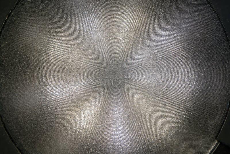 Zamyka w górę widoku laseru metalu rżnięta powierzchnia Round okręgi tworzyli cnc laserową maszyną, nierdzewna metal tekst zdjęcia stock