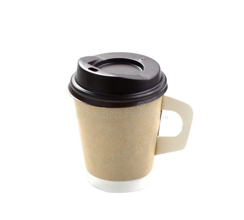 Zamyka w górę wp8lywy kawy z brown nakrętki i filiżanki właścicielem odizolowywającym na białym tle zdjęcia stock