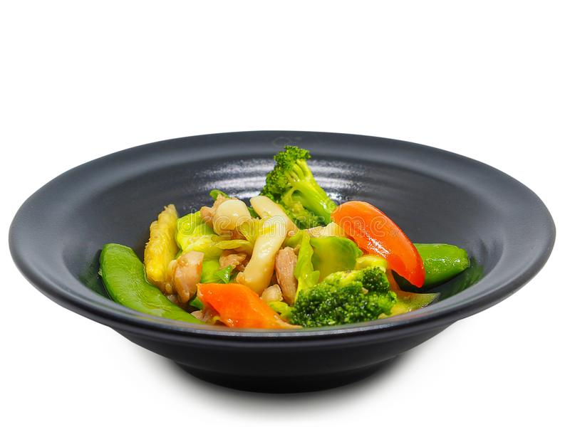 Zanahorias, bróculi, tomates, Fried Vegetables Trayectoria de recortes imagenes de archivo
