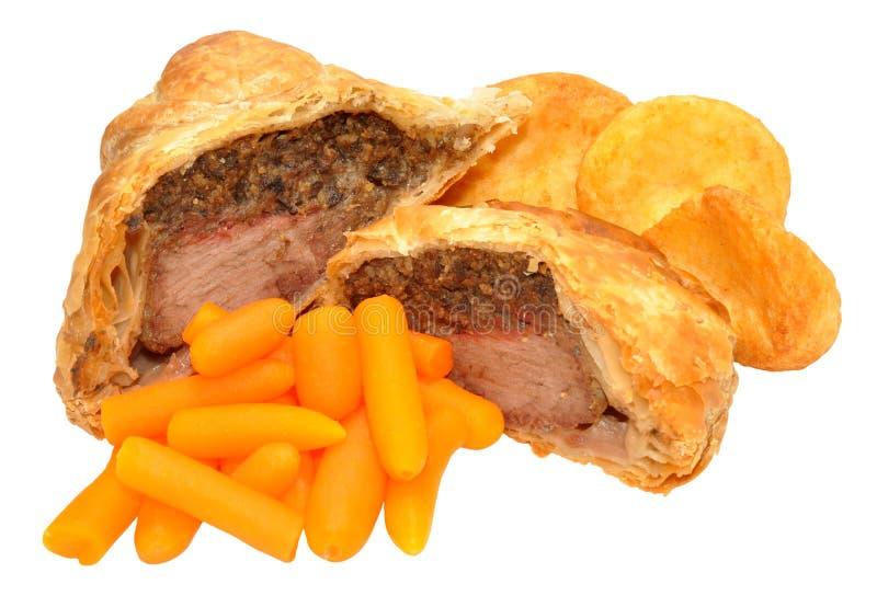 Zanahorias de Wellington With Roasted Potatoes And de la carne de vaca imagen de archivo