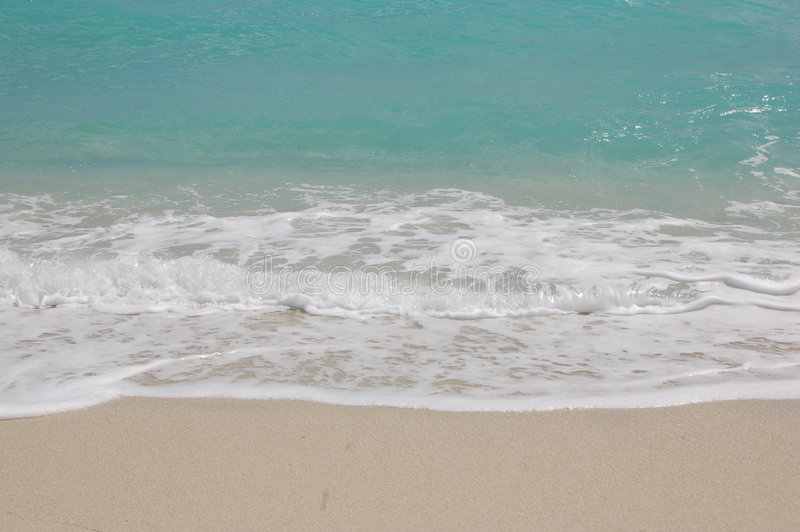 Zand en water stock foto's