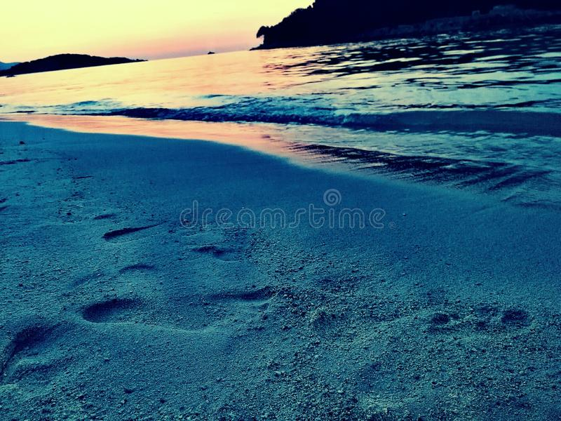 Zand en Zonsondergang stock foto's
