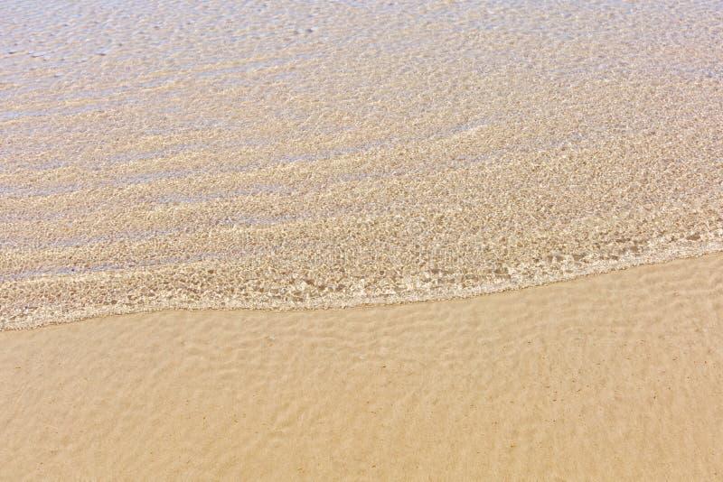 Zand onder het overzees stock foto