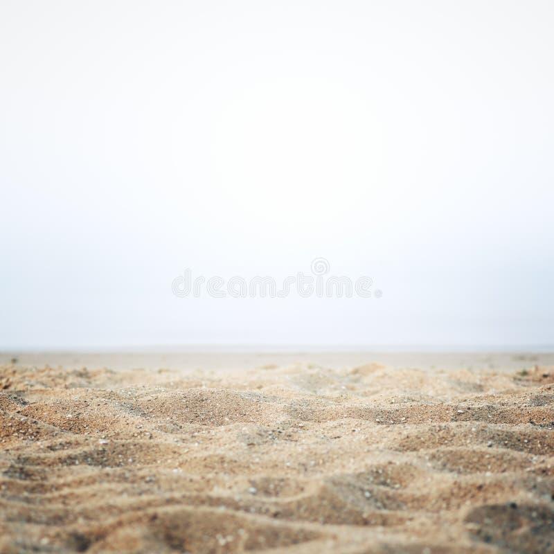 Zand op de kust stock foto