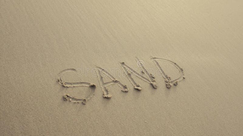 ZAND op het strandzand wordt door golven altijd wordt gewassen geschreven die royalty-vrije stock foto's