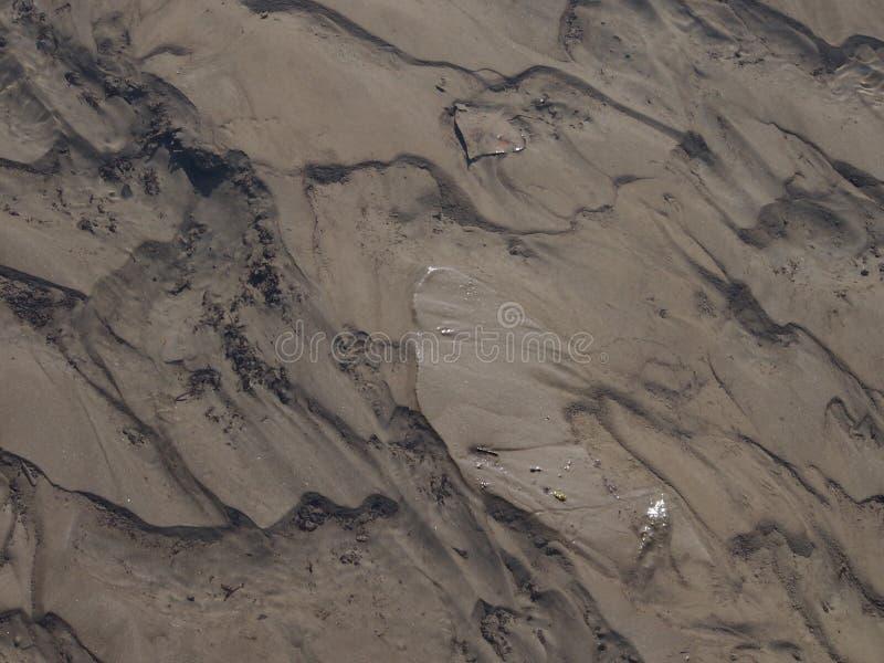 Zand, rivieralluviaal gebied royalty-vrije stock afbeeldingen