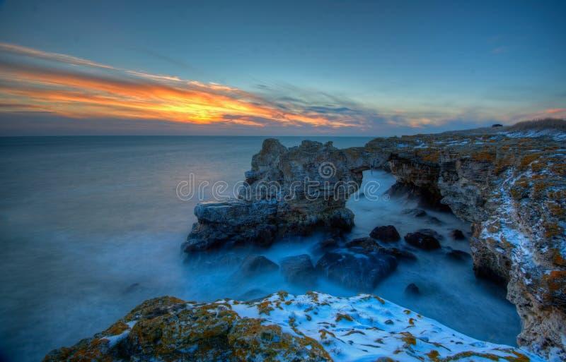 Zandig strand in de Baai stock afbeelding