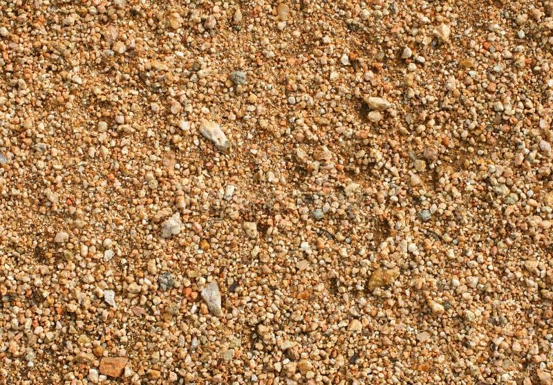 Zandige grond stock afbeeldingen