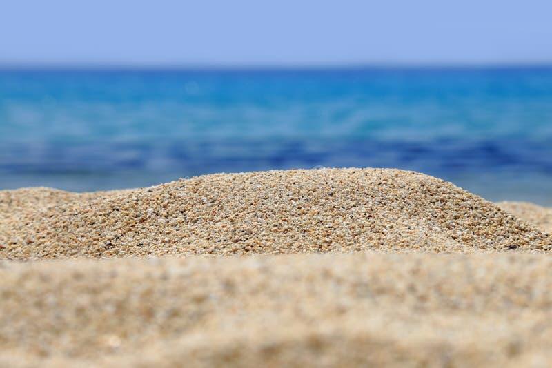 Zandige strandclose-up royalty-vrije stock afbeelding