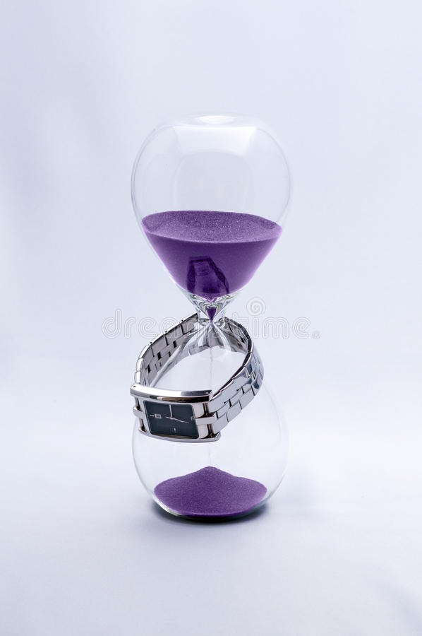 Zandloper en Horloge stock foto