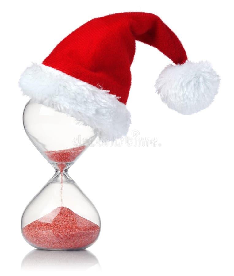 Zandloper met de hoed die van de Kerstmiskerstman de passage van tijd tonen royalty-vrije stock foto's