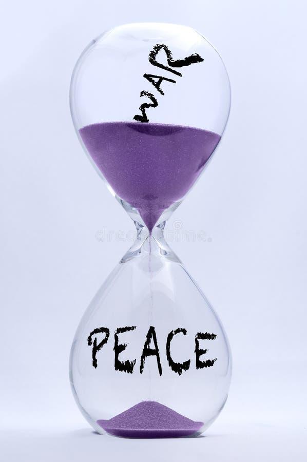 Zandloper - Oorlog en Vrede stock fotografie