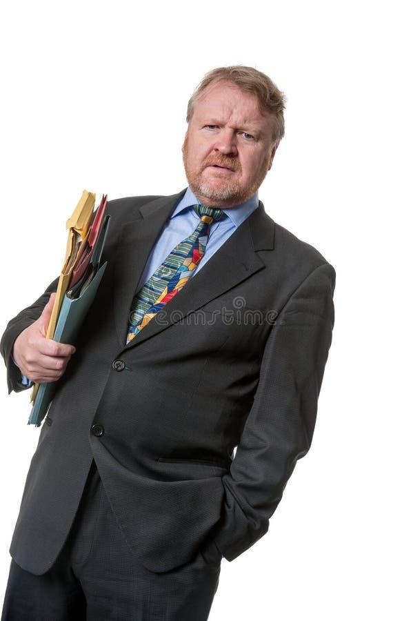 Zaniepokojony biznesmen z falcówkami - na bielu zdjęcie stock