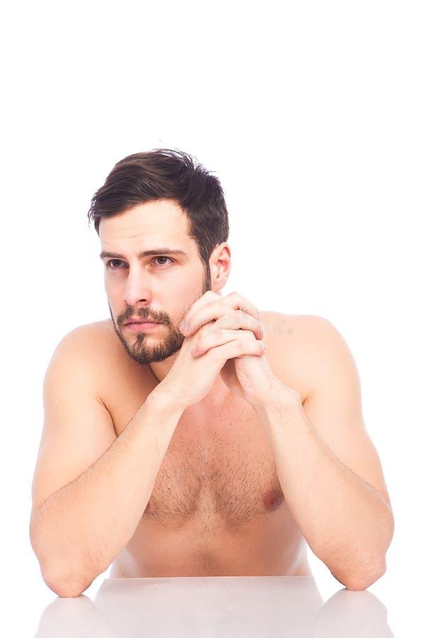 Zaniepokojony mężczyzna bez koszula fotografia royalty free