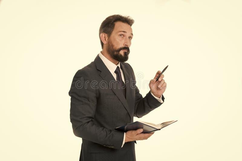 Zanim spotykający pisze puszek informaci musi przenosić i potrzeba pyta Biznesmena planowania rozkładu chwyta notepad Mężczyzna b zdjęcie royalty free