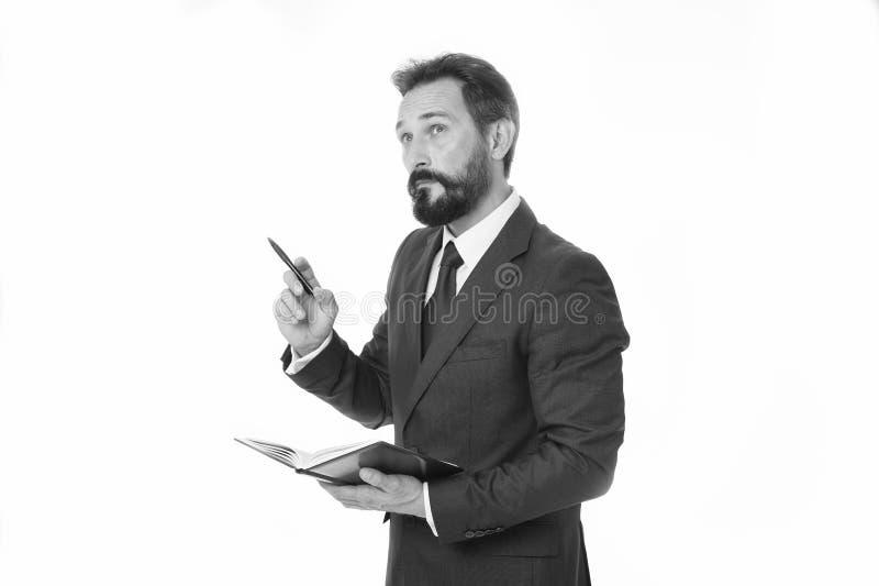Zanim spotykający pisze puszek informaci musi przenosić i potrzeba pyta Biznesmena planowania rozkładu chwyta notepad Mężczyzna b zdjęcia royalty free