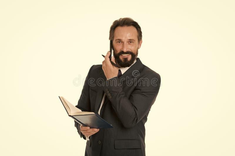 Zanim wezwanie pisze puszek informaci musi przenosić i cokolwiek potrzeba pyta klienta Biznesmen dzwoni klienta chwyta notepad zdjęcie stock