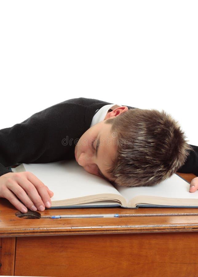 zanudzający szkolny uczeń męczył zdjęcie stock
