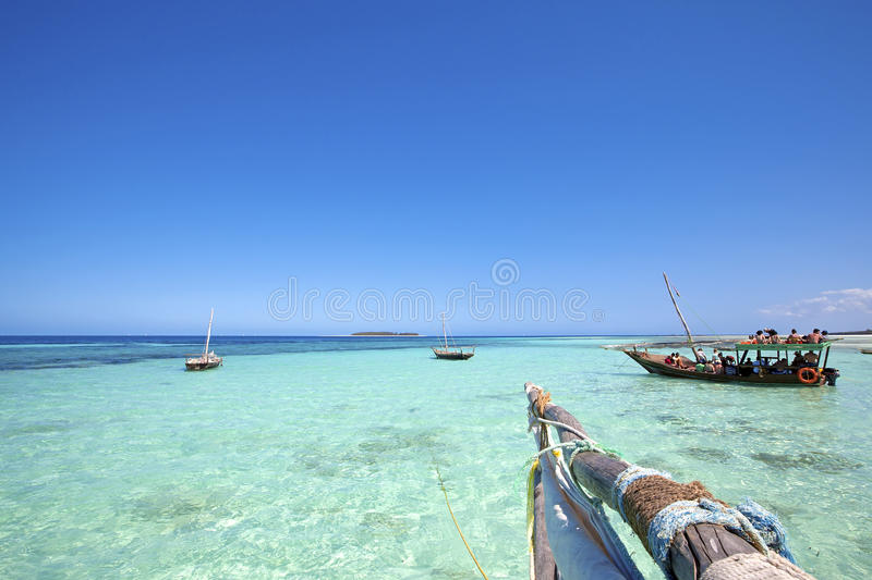 Zanzibar beach. Crystal clear waters at Zanzibar beach in Tanzania royalty free stock image