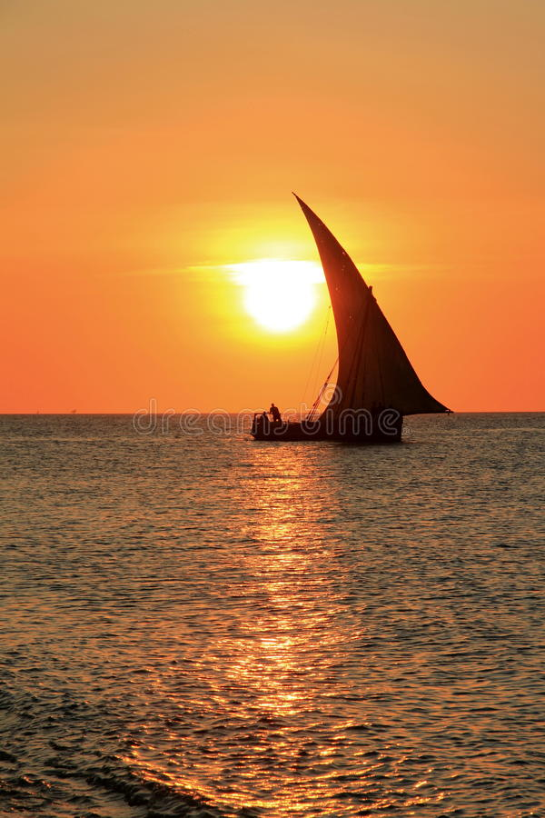 Zanzibar Dhow. A dhow sails through the sunset at Stone town Zanzibar stock images