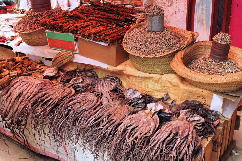 Zanzibar market. Dried octopuses and spices at a Zanzibar market royalty free stock images