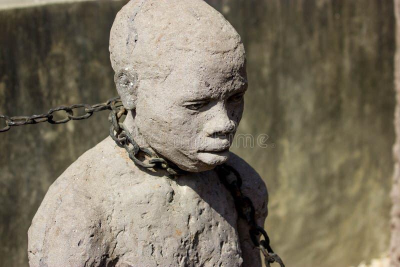Zanzibar, Steenstad Monumenten afgetobde bedienden stock foto's