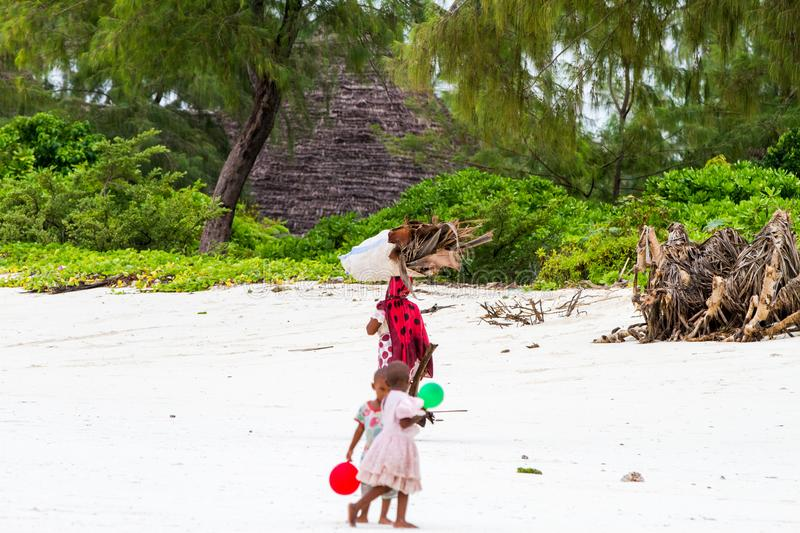 Unknown children playing on Paje beach royalty free stock image