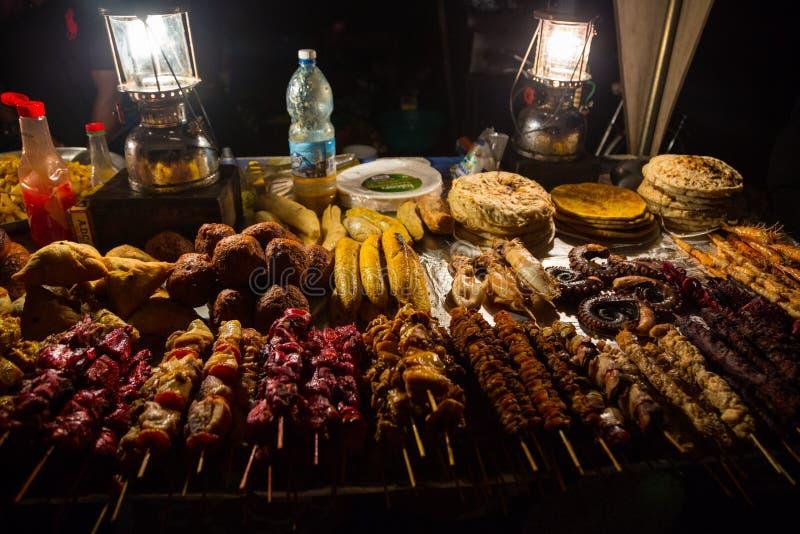 Zanzibari night street food market in Forodhani Gardens. Stone Town, Zanzibar City, Unguja island, Tanzania. stock photos