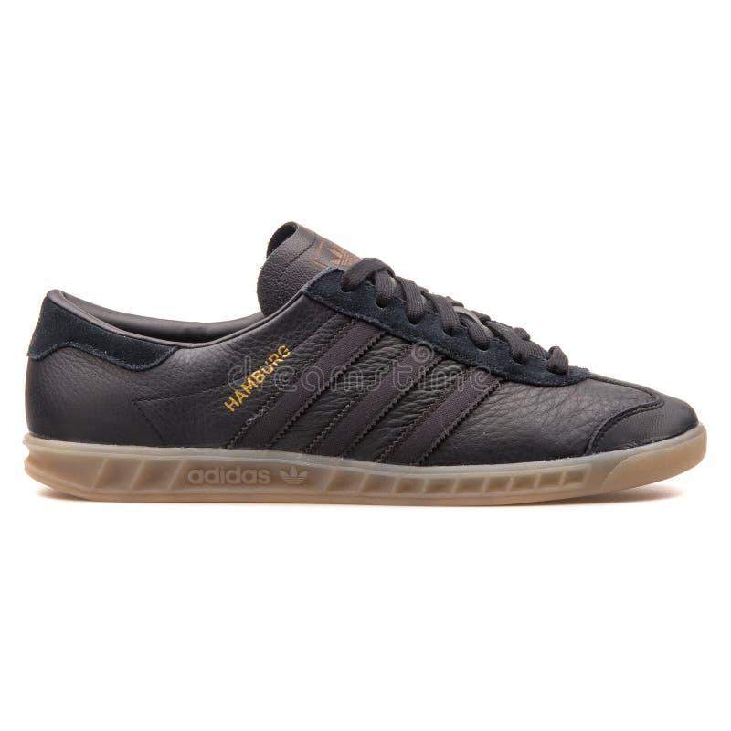 Zapatilla de deporte del negro de Adidas Hamburgo imagen de archivo