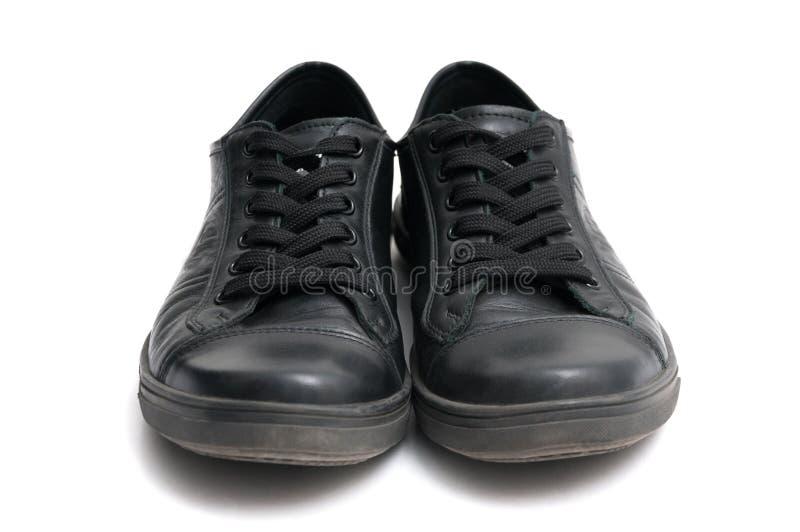 Zapatillas de deporte negras imagen de archivo libre de regalías