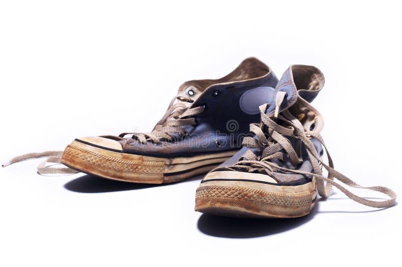 Zapatillas de deporte sucias fotos de archivo libres de regalías