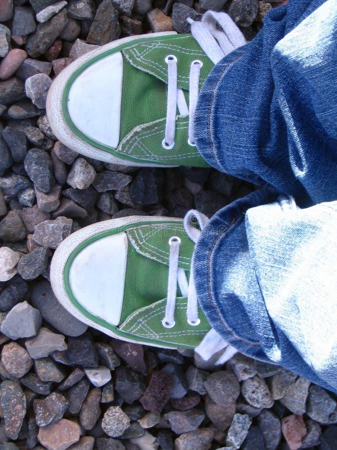Zapatillas de deporte verdes imagen de archivo