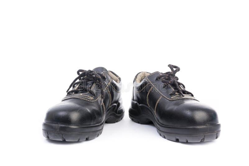 Zapato de seguridad negro aislado imagenes de archivo
