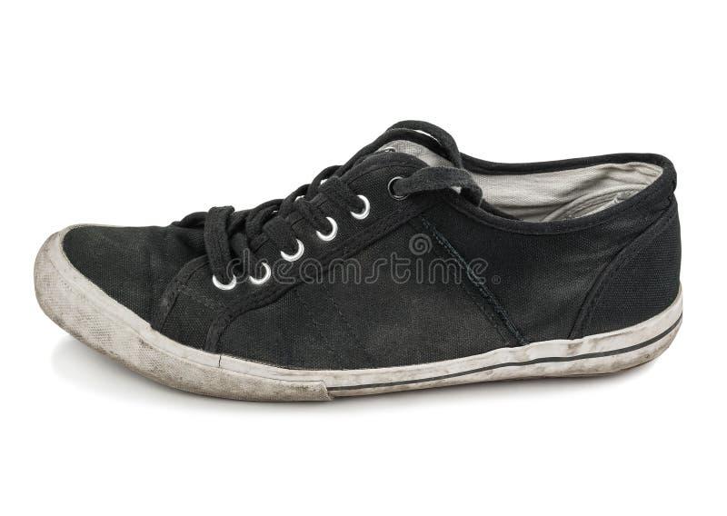 Zapato negro viejo del deporte imágenes de archivo libres de regalías