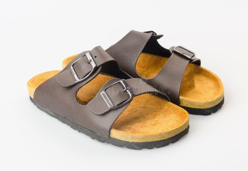 zapato o sandalia femenina de la moda en fondo imagenes de archivo