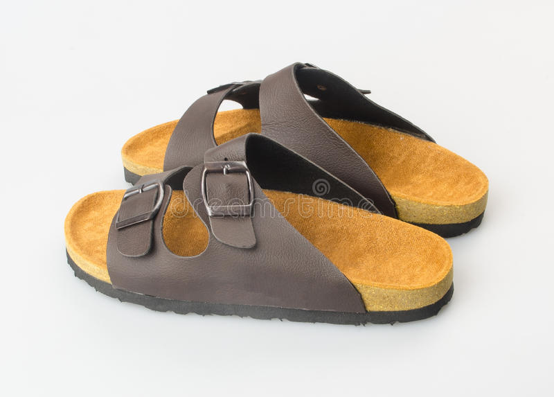 zapato o sandalia femenina de la moda en fondo foto de archivo libre de regalías