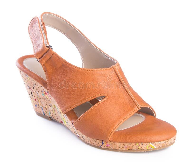 zapato sandalia de la mujer en un fondo fotografía de archivo