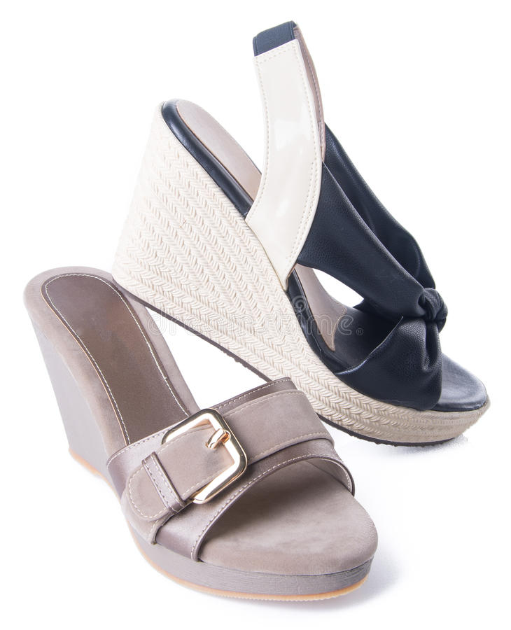 zapato sandalia de la mujer en un fondo foto de archivo
