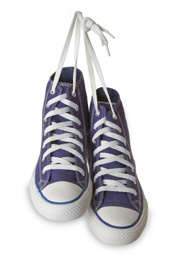 Zapatos azules del deporte imagen de archivo libre de regalías