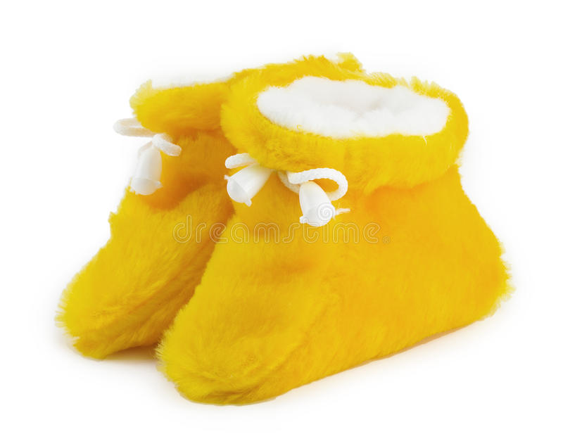 Zapatos de bebé amarillos fotografía de archivo