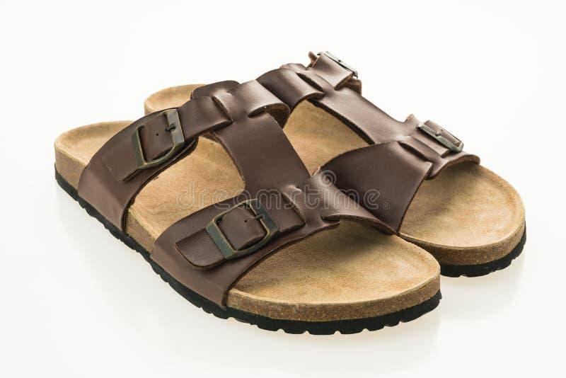 Zapatos de cuero de la sandalia y de la chancleta de los hombres fotografía de archivo libre de regalías