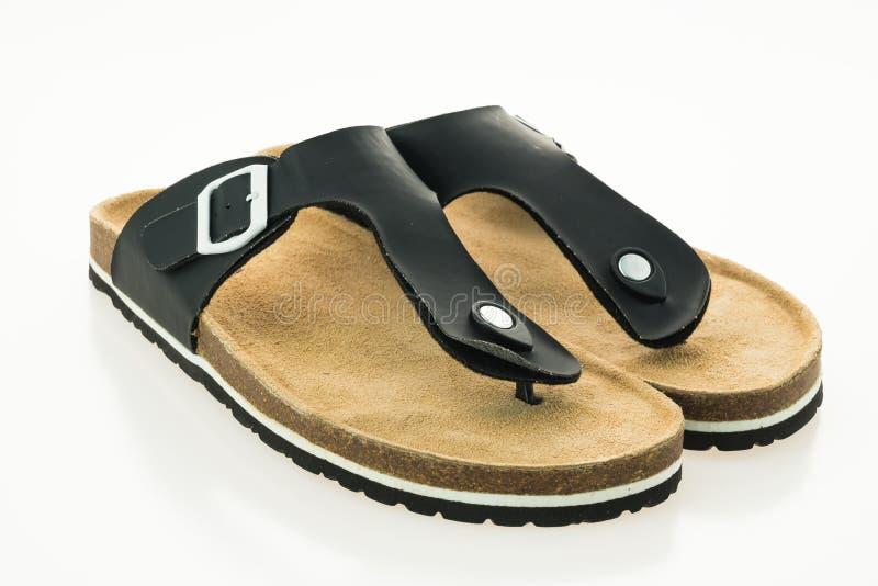 Zapatos de cuero de la sandalia y de la chancleta de los hombres imagen de archivo libre de regalías